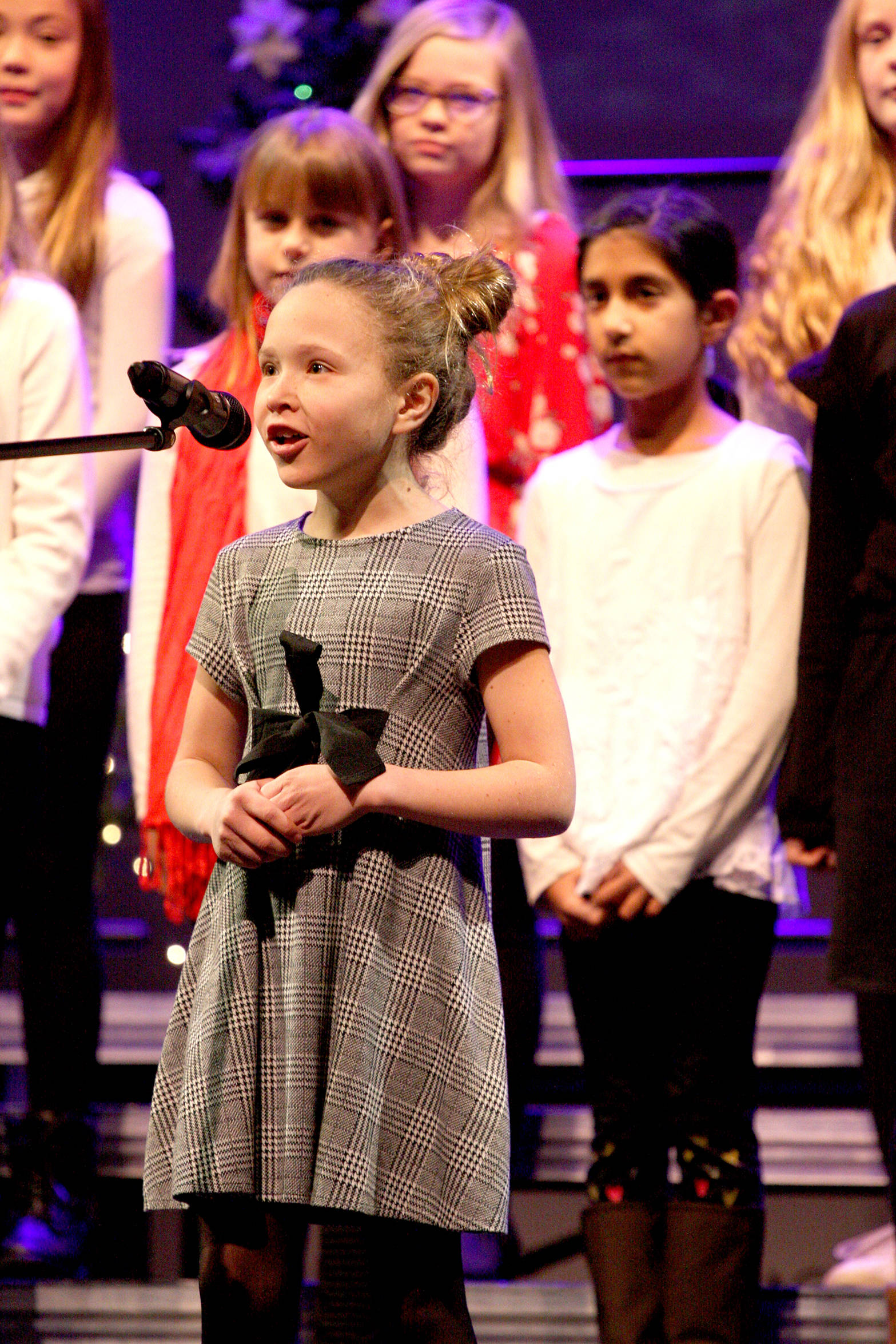 """Autumn Sunderland sings a solo for """"We Need a Little Christmas"""" with fellow BX Elementary choir members during last year's Rotary Carol Festival, which returns this weekend to the Vernon and District Performing Arts Centre. (Jennifer Smith - Morning Star)"""