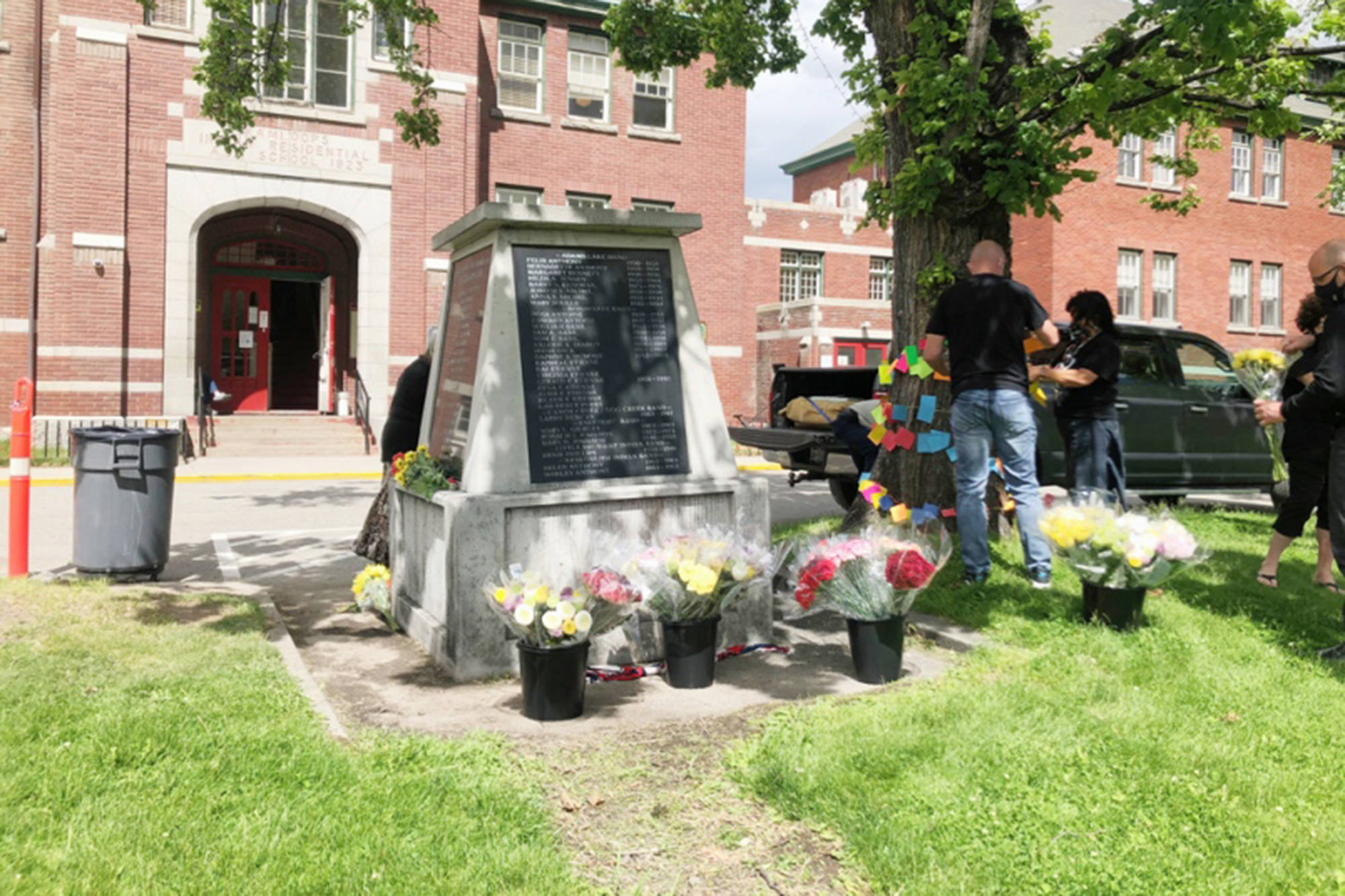 Members of the public have been visiting the memorial in front of the Kamloops Indian Residential School building, dropping off flowers as a show of support to the Tk'emlups te Secwepemc community in wake of the discovery of the remains of 215 children who attended the school, which operated between 1890 and 1977. (Ian Matheson photo)